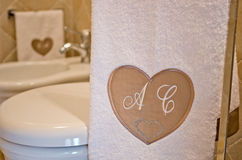 Personalized bath with your taste, warm and cozy fabrics. And a heart with your initials Stock Images