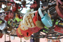 Personalized Wedding locks. Russian tradition - to hang padlocks engraved on the fence of the bridge Stock Image