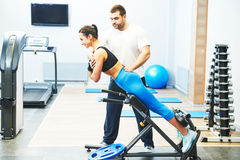 Personall trainer work in gym Stock Photography