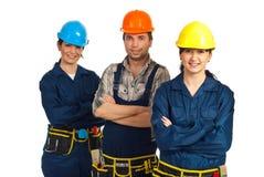 Personas alegres de tres trabajadores del constructor fotos de archivo libres de regalías