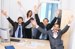 Personas alegres del asunto en oficina Imágenes de archivo libres de regalías