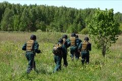Personas de GOLPE VIOLENTO en un entrenamiento. Imagen de archivo