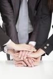 Personas del asunto con la mano junto Fotografía de archivo