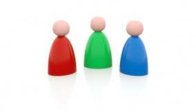 3 personas en diversos colores Imagenes de archivo