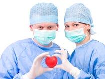 Personas médicas con el corazón Imagen de archivo