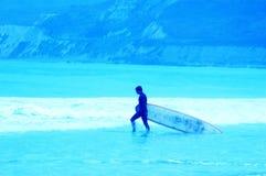 Personas que practica surf azules 10 Imagen de archivo libre de regalías
