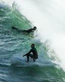 Personas que practica surf en el perran Foto de archivo libre de regalías