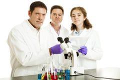 Personas serias de científicos Imagen de archivo libre de regalías