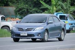 Personbil Toyota Corolla Altis arkivbild