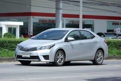 Personbil Toyota Corolla Altis royaltyfria foton