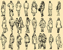 Persone che camminano nella via Fotografie Stock