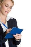 Personen-Schreibens-Check Lizenzfreie Stockbilder