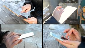 Personenmädchen, das an der Tablette sitzt an einer Holztischnahaufnahme arbeitet stock video