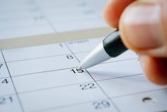 Personhandstil på ett kalenderdatum av 15th Fotografering för Bildbyråer