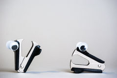 Personified Staple Removers. Photograph of staple removers with oogly eyes on a white background Stock Image