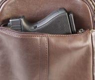 Personligt vapen i handväska Fotografering för Bildbyråer