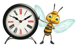 personnage de dessin animé d'abeille d'amusement avec l'horloge Photo libre de droits