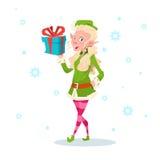 Personnage de dessin animé Santa Helper Hold Present Box de fille d'Elf de Noël Images stock