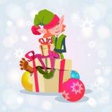 Personnage de dessin animé Santa Helper With Present Box de fille d'Elf de Noël Image libre de droits