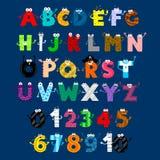 Personnages de dessin animé de monstre d'alphabet et de nombres Images libres de droits
