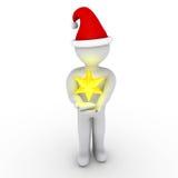 Personne avec l'étoile de Noël Photos stock