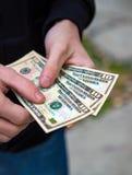 Personne avec un argent photos libres de droits