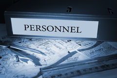 Personnel on blue business binder. The word personnel on blue business binder on a desk stock photo