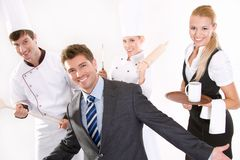 Personnel de sourire de restaurant photographie stock libre de droits