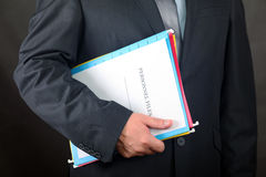 Personnel Files. Businessman holding Personnel Files folder royalty free stock image
