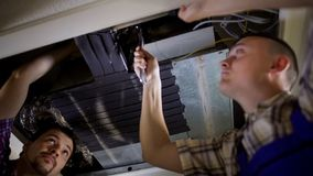 Personnel fixing air conditioning system in building, technical maintenance. Stock photo royalty free stock image