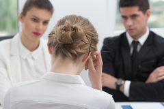 Personnel managers during interview. Image of personnel managers during interview with female candidate stock photos