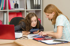Personnel Specialist carefully studying the certificate of professional development of women Stock Photos