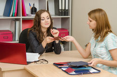 Personnel Specialist looks diplomas and certificates of professional development of women Stock Images
