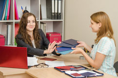 Personnel Specialist smiling girl refuses to look diplomas jobseekers stock photography