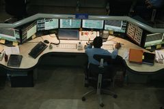 Personnel at work in control room on a chemical plant Royalty Free Stock Images