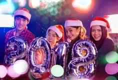 Personnes asiatiques à la fête de Noël Image libre de droits