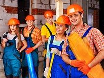 Personnes de groupe dans l'uniforme de constructeur Photo stock