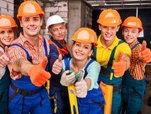 Personnes de groupe dans l'uniforme de constructeur Image stock