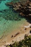 Personnes de la Sardaigne dans la baie du testa de capo Image libre de droits