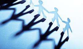 Personnes de papier bleu dans le concept teamworking Image libre de droits