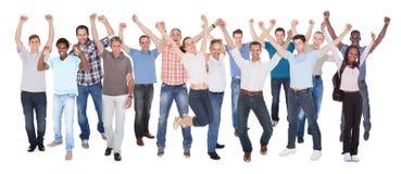 Personnes diverses dans les vêtements sport célébrant le succès Photos libres de droits