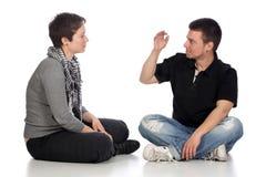 personnes expliquantes sourdes de main Image libre de droits