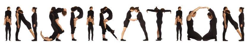 Personnes habillées par noir formant le mot INSPIRATION Images libres de droits