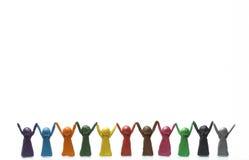 Personnes heureuses avec la haute de mains augmentée Photos libres de droits
