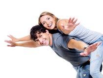 Personnes heureuses avec les mains soulevées vers le haut Image libre de droits