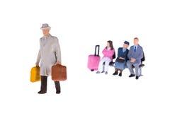 Personnes miniatures d'homme d'affaires et de touriste Photo stock