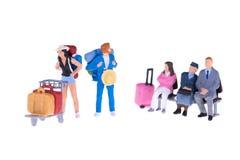 Personnes miniatures d'homme d'affaires et de touriste Photo libre de droits