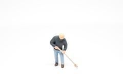 Personnes miniatures nettoyant le concept sur le fond avec un espace Photographie stock libre de droits