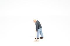 Personnes miniatures nettoyant le concept sur le fond avec un espace Photo libre de droits