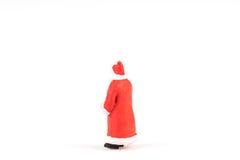 Personnes miniatures Santa Claus sur le fond avec l'espace pour le texte Photo stock